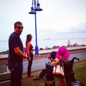 Gaeylnn busking on the Lakewalk on Sunday of the Duluth Homegrown Music Festival 2015 (in the pink hat),  Sean Roderick (seated),  Aleasha Hladilek (red tanktop) & HUMANOID